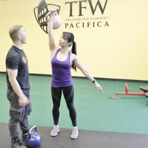 Of course I wanted to use the pink kettlebell - With Tim Chau of Trainng for Warriors Pacifica - Berniedette of Petite And Toned