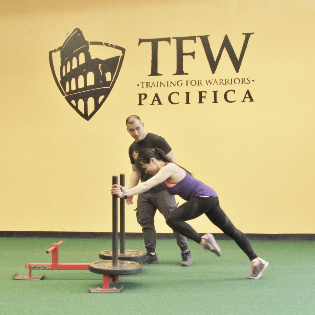 Tim Chau motivating me to push the sled faster - Training for Warriors Pacifica - Berniedette of Petite And Toned